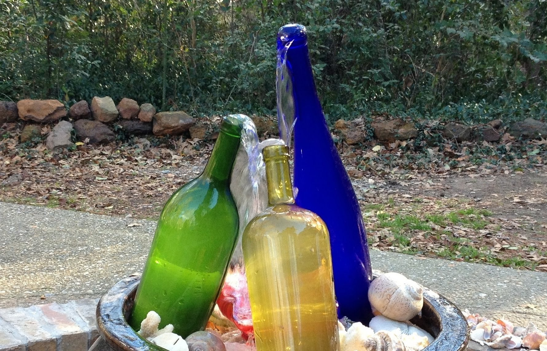 How to make cool diy wine bottle fountain 4 diy tag for Making a water garden